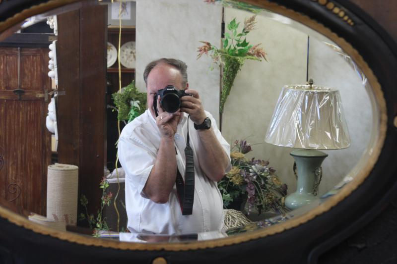 Dan taking a photo of himself at Design Essence in Old Saybrook, CT